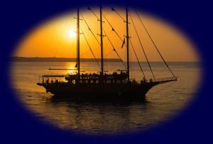 Old Sailing Ship at Sea During Sunset