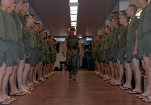 "Senior Drill Instructor inspects his platoon prior to ""lights out ..."