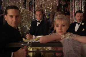 Tobey Maguire as Nick Carraway, Leonardo DiCaprio as Jay Gatsby, and ...