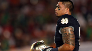 Manti Te'o of the Notre Dame Fighting Irish warms up prior to playing ...