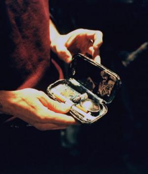 of addict displaying small case containing crank (methamphetamine ...