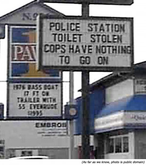 ... police signs: Police station toilet stole. Cops have nothing to go on