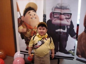 Great costume! It's Russell, the kid from Up .