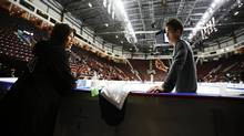 Patrick Chan of Canada speaks to his coach Kathy Johnson during ...