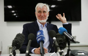 Professor John O'Keefe answers a question during a news conference in ...