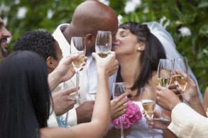 Guests toasting bride and groom on wedding day - Ariel Skelley/ Blend ...