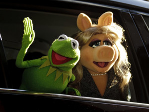 Miss Piggy and Kermit the Frog sign on as presenters