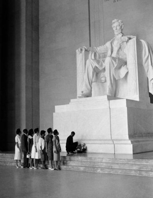 The statue of Abraham Lincoln dwarfs seven African American students ...