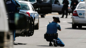Law enforcement officers react to what was initially thought to be a ...