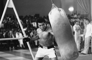 Ali working out before his upcoming bout against George Foreman ...