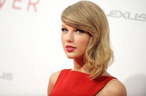 Taylor Swift attends 'The Giver' premiere at Ziegfeld Theater on ...