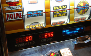Insert Coin At The Slot Machine