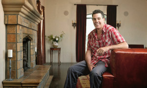 Adam Carolla and his Batchelder fireplace