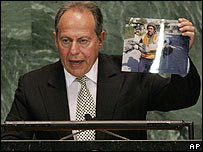 Mr Lahoud held up a picture of a child casualty of the conflict
