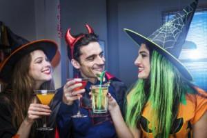 Halloween witches and devil toasting cocktails - Betsie Van Der Meer ...