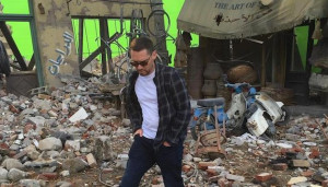 ... Bryan Singer captions a photo of him walking between destroyed