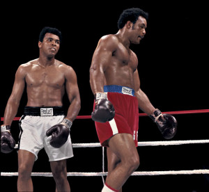 """Muhammad Ali stares down George Foreman during their 1974 """"Rumble in ..."""