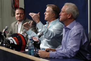 Broncos vice president John Elway, center, is flanked by head coach ...