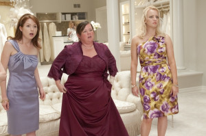 melissa mccarthy and the movie poster in which melissa has been ...