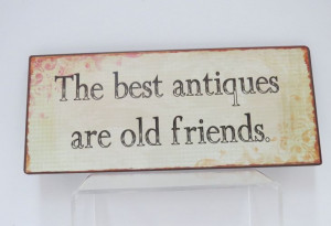 sign displays a quote many can be inspired by, 'The best antiques ...