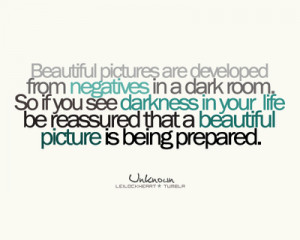 Beautiful pictures are developed from negatives in a dark room.