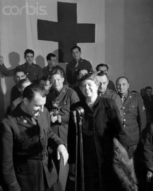 First Lady Eleanor Roosevelt is surrounded by American soldiers while ...