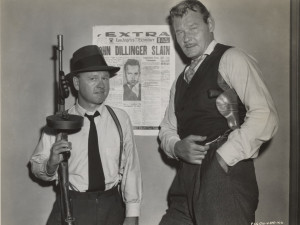 Partnering Mickey Rooney in Baby Face Nelson (1957).