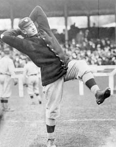 Christy Mathewson winding up for the pitch