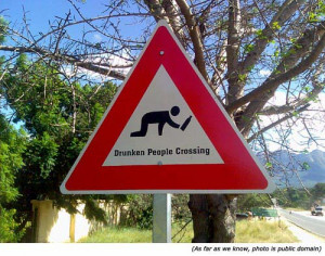 Funny road sign: Drunken People Crossing!