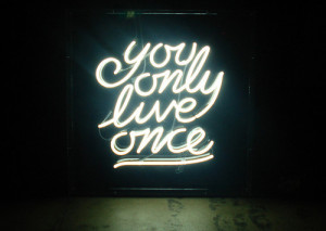 "You only live once"" quote written in neon lights"