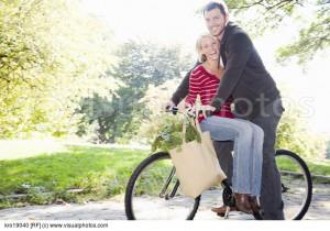 couple riding same bicycle kro19040 jpg
