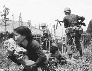 Eddie Adams -Vietnam, 1965 -Marine Crossfire