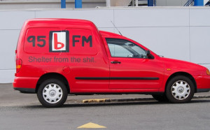 "... the sh*t"" on the side of a radio station van on a public street"