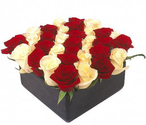 This is a nice life celebration floral arrangement because the roses ...