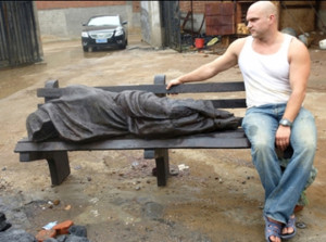 Canadian sculptor Timothy P. Schmalz with a 'Homeless Jesus' statue.