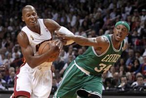 Boston Celtics forward Paul Pierce (R) fouls Miami Heat guard Ray ...