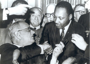 ... 1964-LBJ-signs-hands-pen-to-Martin-Luther-King-Jr-July-2-1964-650x463