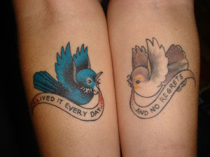 ... bird, in these symmetrical arm tattoos. Meaningful text banners