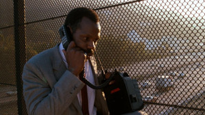 Danny Glover as Roger Murtaugh on a mobile phone in