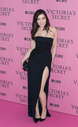 Daisy Lowed looked classically sexy in a long, thigh-split black frock ...