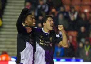 ON-TRENT, ENGLAND - Sunday, January 12, 2014: Liverpool's Luis Suarez ...
