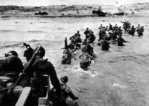 troops disembark from a landing vehicle on Utah Beach on the ...