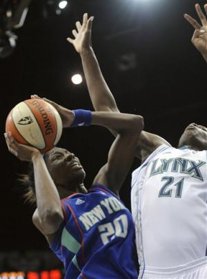 The Lynx' Nicky Anosike shoots over Shameka Christon/AP photo Hannah ...