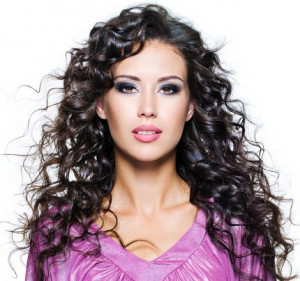 Beautiful long curly hair flowing down the shoulders ...