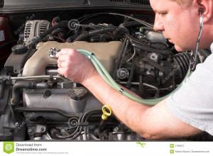 mechanic diagnosing engine problems.