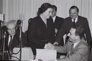 Golda Meir shakes hands with Moshe Sharett after signing Israel's ...