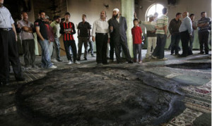 ... in the West Bank village of Al Mughayer, near Ramallah, Tuesday, (AP