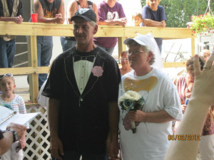 The bride and groom wore t-shirts and hats and got married at their ...