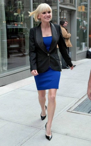 Anna Faris was spotted leaving her hotel with a jacket over her blue ...