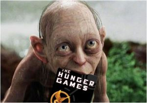 Smeagol eating The Hunger Games book